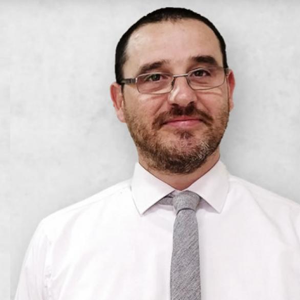 Dr. Adrian Mallia